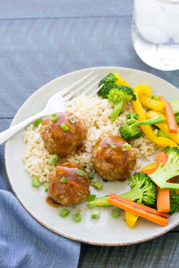 Sweet and sour meatballs are so tender and flavorful! You can make them ahead for a quick freezer meal for weeknight dinners. You will love the homemade 3 ingredient sweet and sour sauce! These healthy baked meatballs are made with ground turkey, ginger and hoisin.