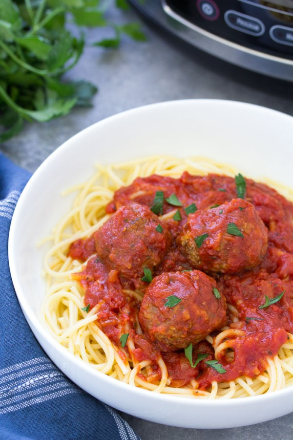 Traditional crock pot meatballs with spaghetti ready to eat in a bowl.