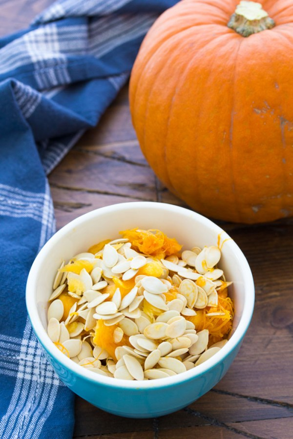 How to make perfectly crunchy roasted pumpkin seeds. An easy method for how to clean and make baked pumpkin seeds. Plus delicious ideas for seasoning your roasted pumpkin seeds, including sweet and salty and maple cinnamon!
