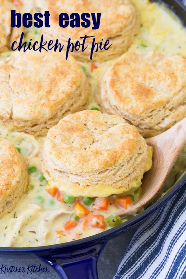 Homemade chicken pot pie with biscuits on a serving spoon.