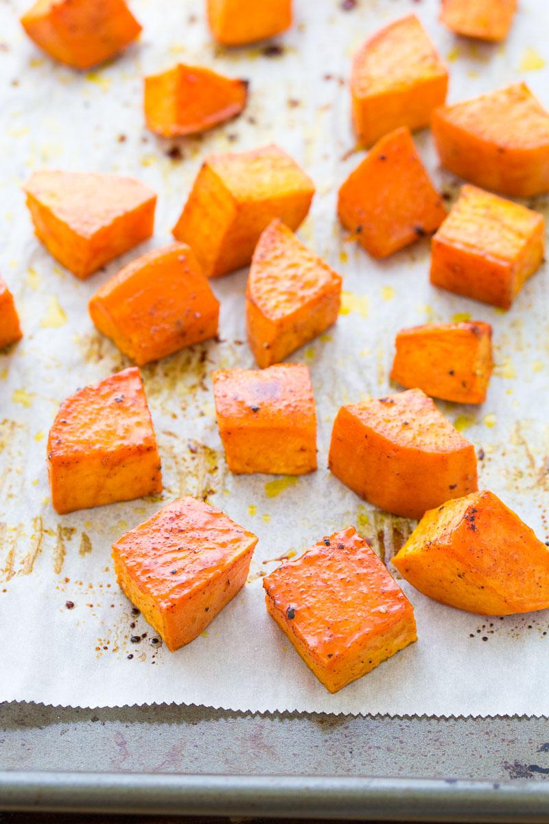 baked sweet potato cubes on a baking sheet