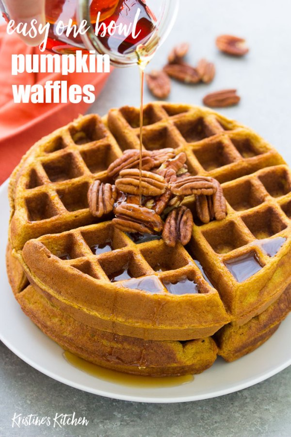 Healthy pumpkin waffles with pecans and maple syrup