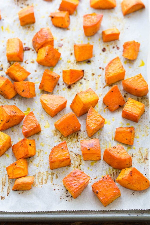 baked sweet potatoes on a pan.