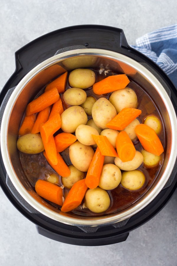 Add the potatoes and carrots to the pressure cooker and cook ten minutes more. How to make Instant Pot Pot Roast.