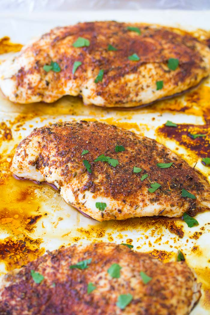 Baked chicken on a baking sheet.