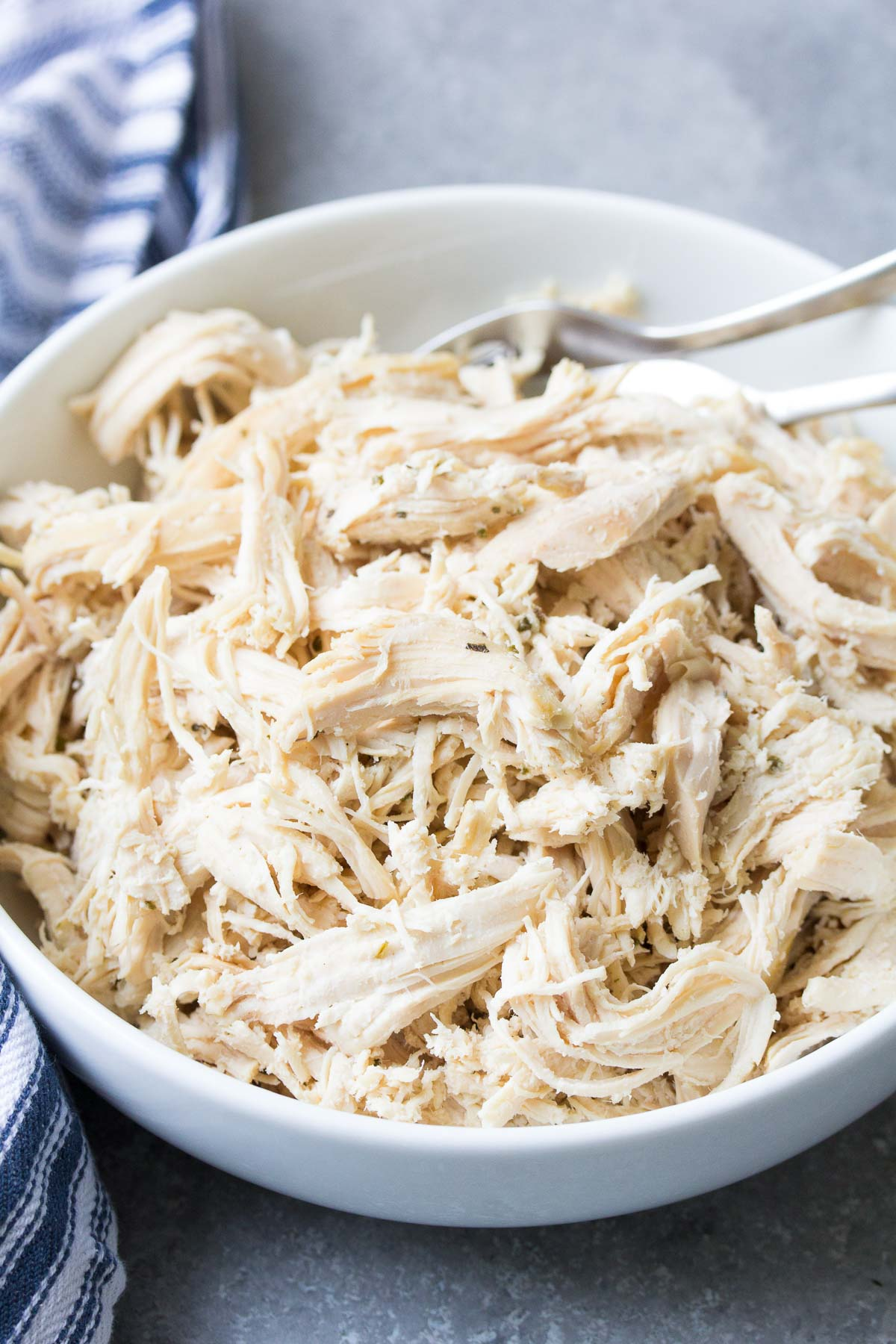 instant pot shredded chicken in a white bowl