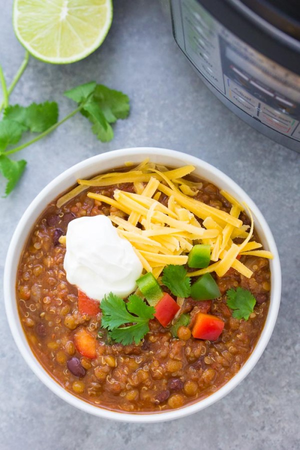 Vegetarian lentil chili in a bowl with toppings. Make it in your Instant Pot or crock pot.