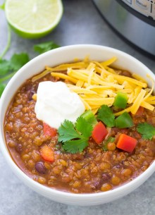 Easy Instant Pot Vegetarian Lentil Chili in a bowl with toppings. Crockpot directions also included.