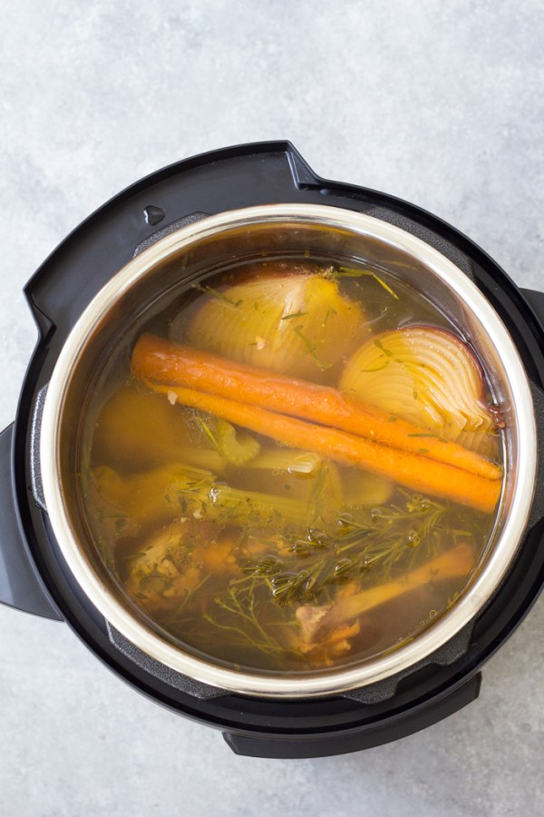 Instant Pot bone broth in the pressure cooker after cooking.