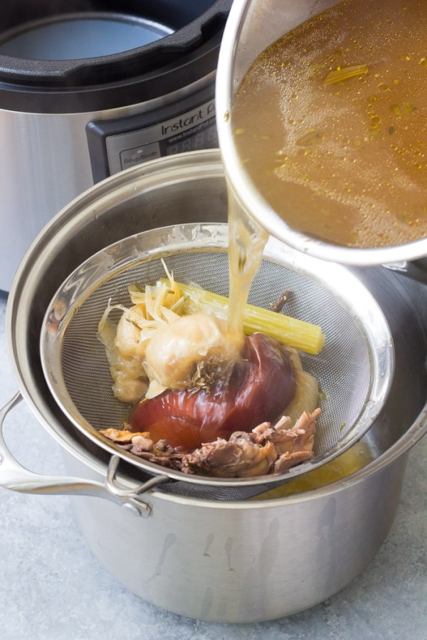 How to make Instant Pot bone broth: straining the cooked broth.