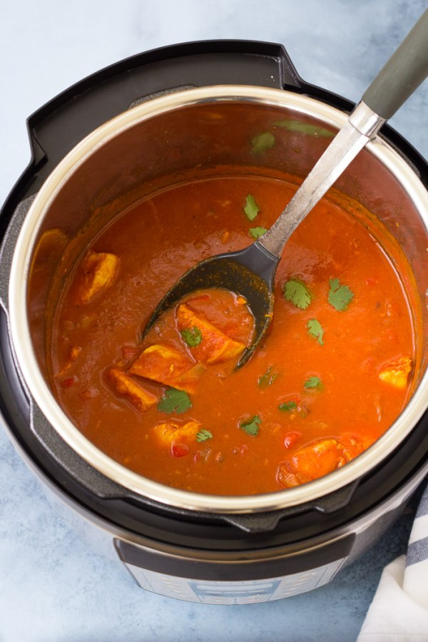 Butter chicken in a tomato and coconut milk curry sauce, in an Instant Pot.