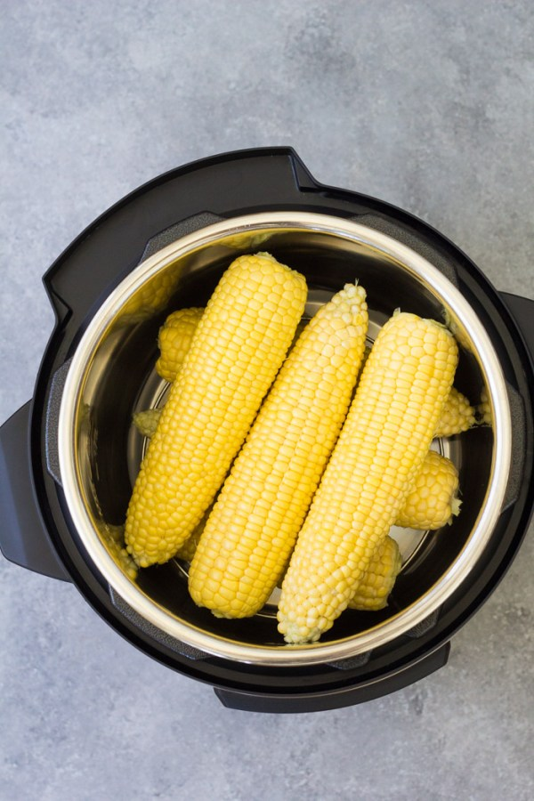 Corn on the cob in an Instant Pot, before cooking.