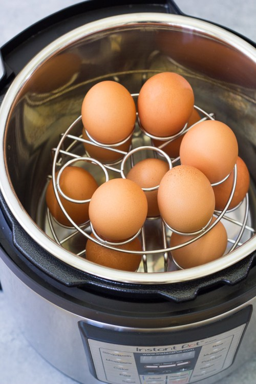 Hard boiled eggs cooked on stackable egg racks in an Instant Pot.