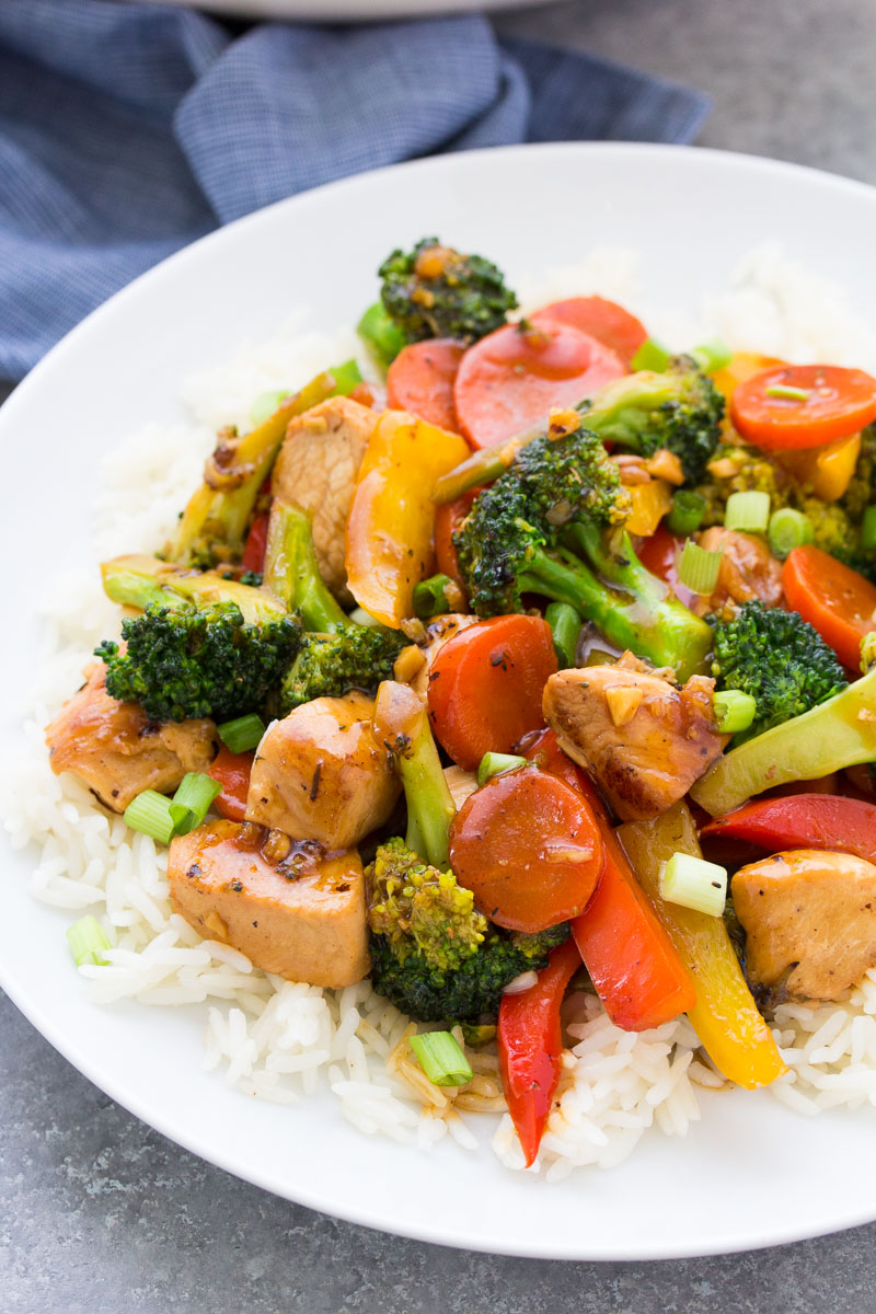 Stir fry with chicken and veggies served over rice.