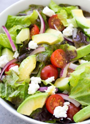 Close up of green salad with avocado.