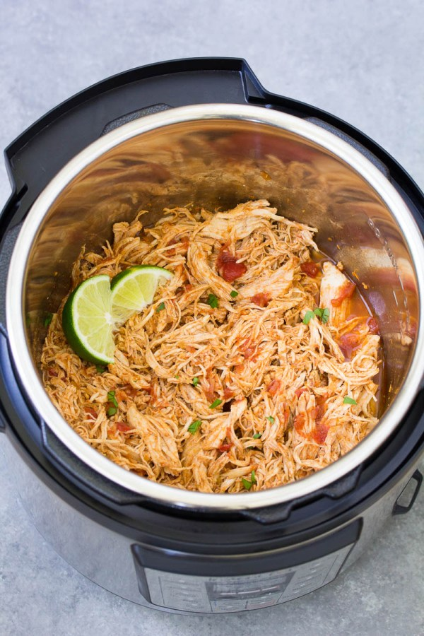 Shredded salsa chicken in an Instant Pot.