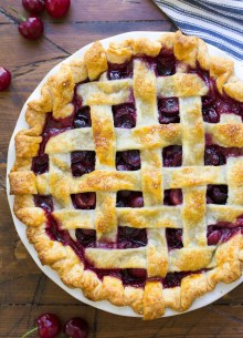 Whole cherry pie with lattice crust, after baking.