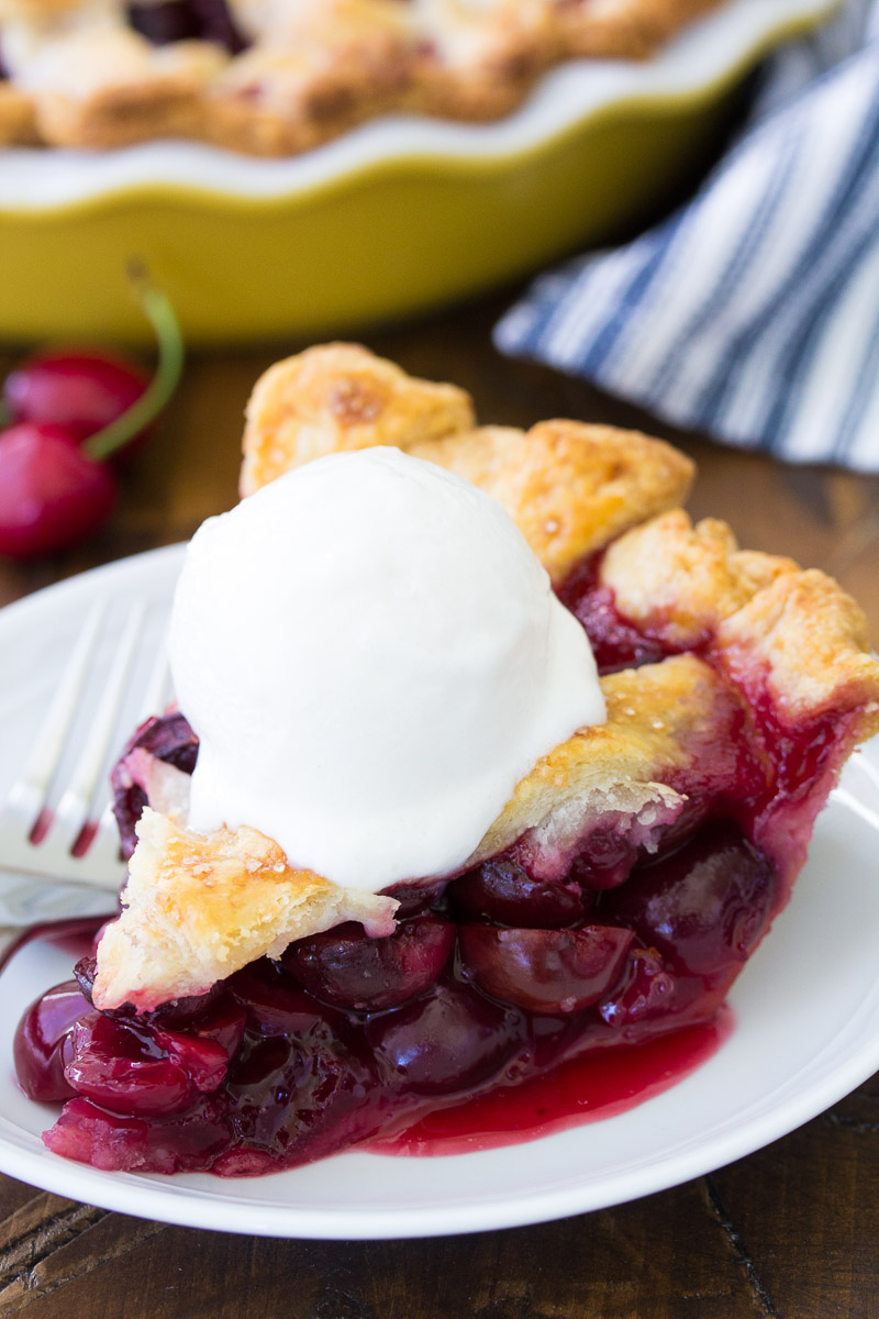 Slice of pie with a scoop of vanilla ice cream on top.