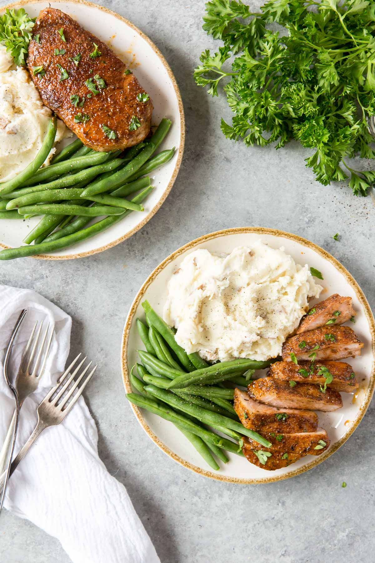 baked pork chops served with mashed potatoes and green beans