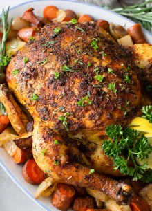 crockpot whole chicken and vegetables on a serving platter