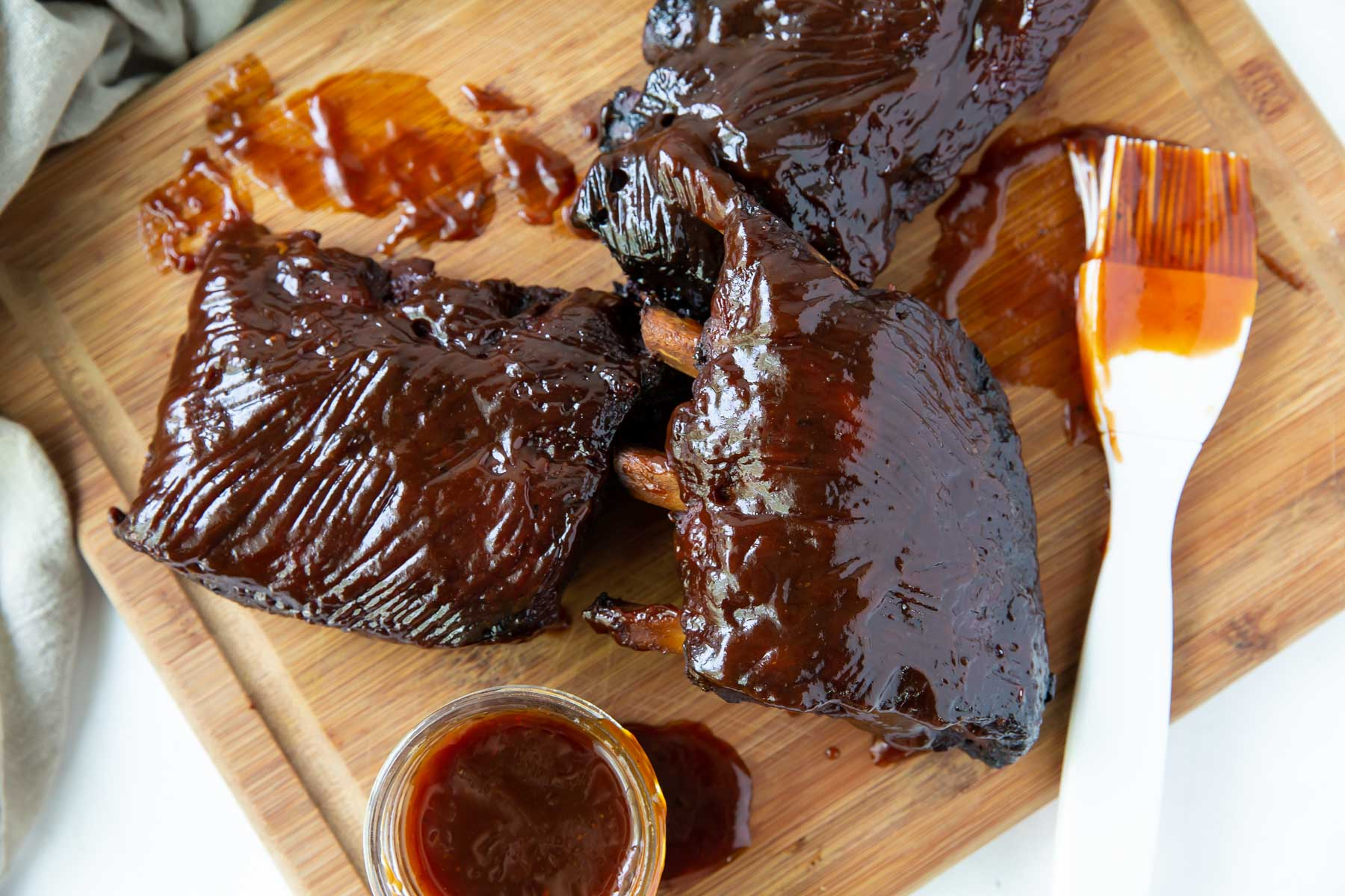 cooked ribs brushed with bbq sauce