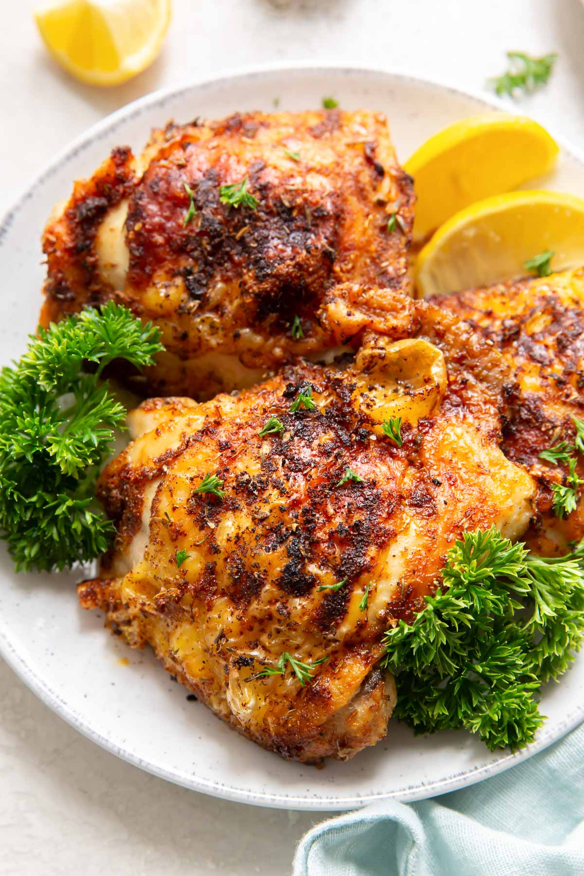 close up of crispy chicken thighs on a plate