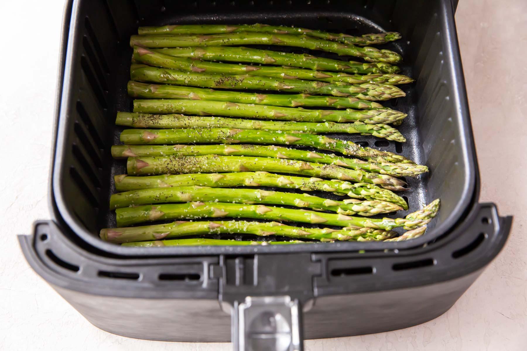 asparagus in air fryer basket before cooking