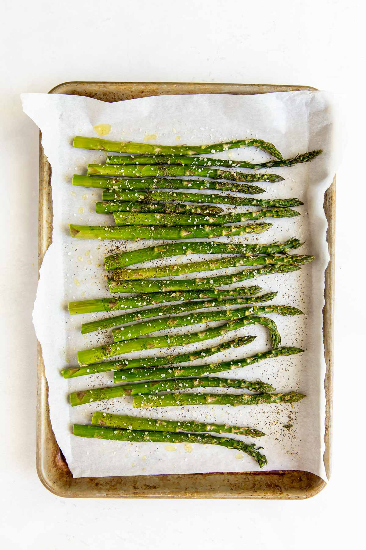 baked asparagus on baking sheet