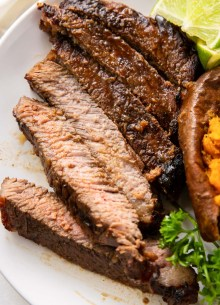 sliced marinated grilled steak served with sweet potato