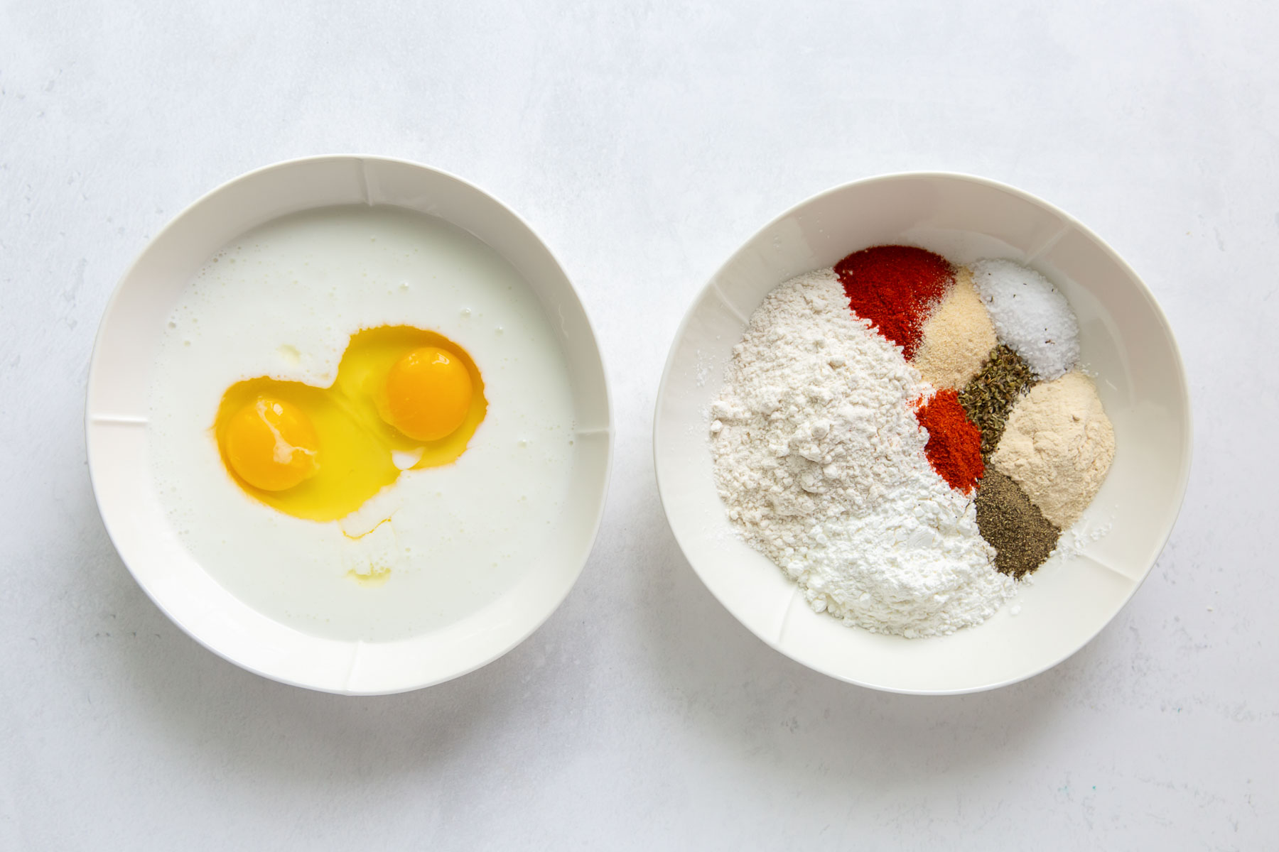 Buttermilk and eggs in one bowl; flour, cornstarch and seasonings in another bowl.