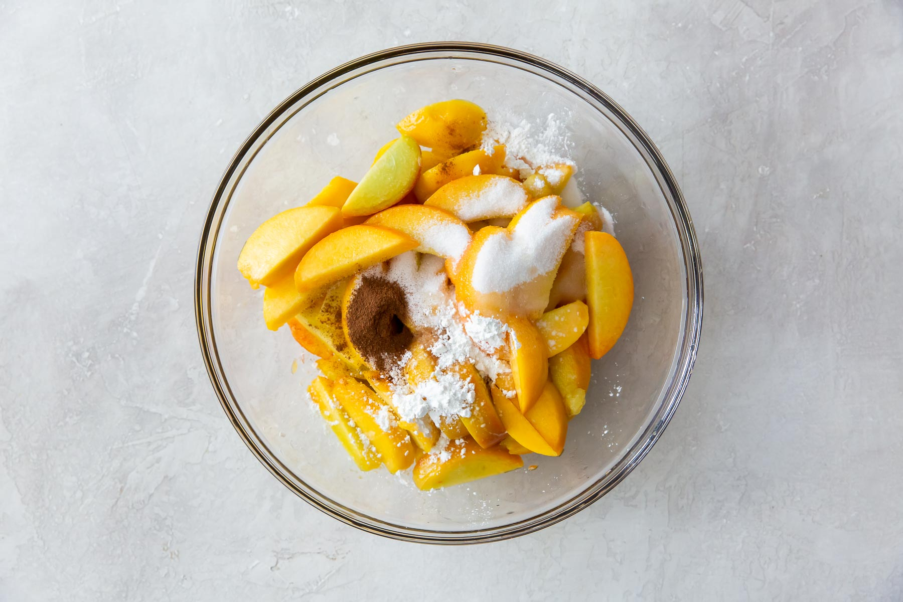 peaches and other filling ingredients in mixing bowl