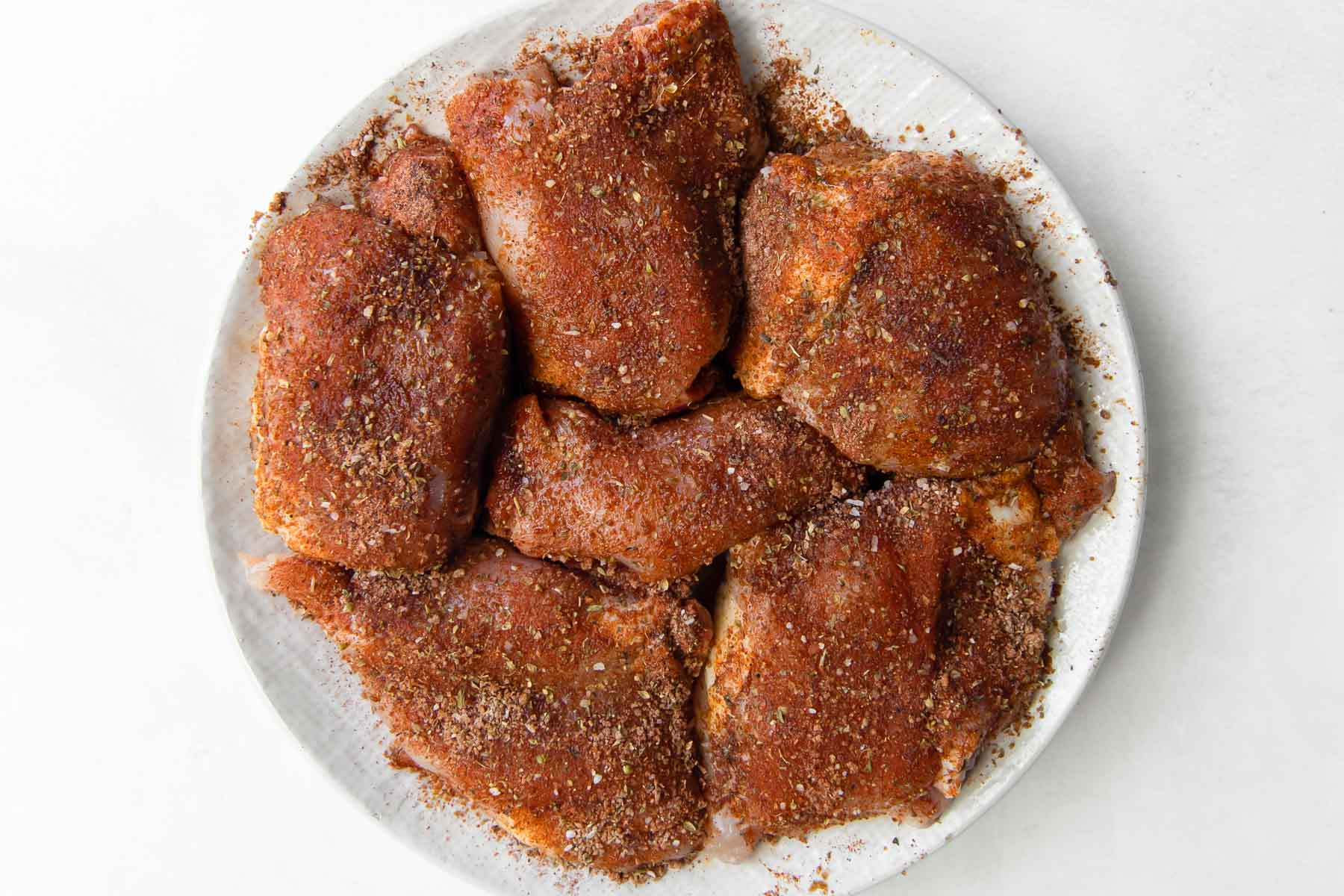 chicken thighs coated with seasoning