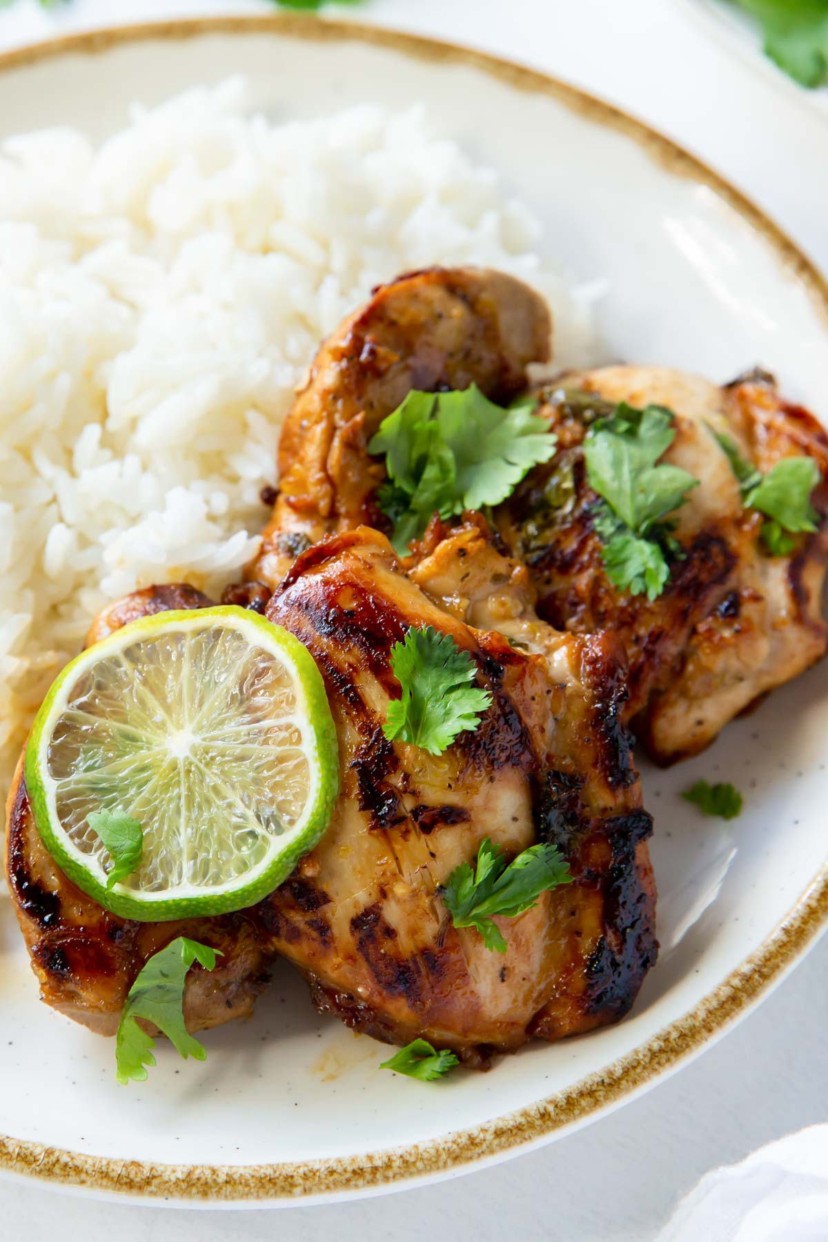 two cilantro lime chicken thighs served with white rice