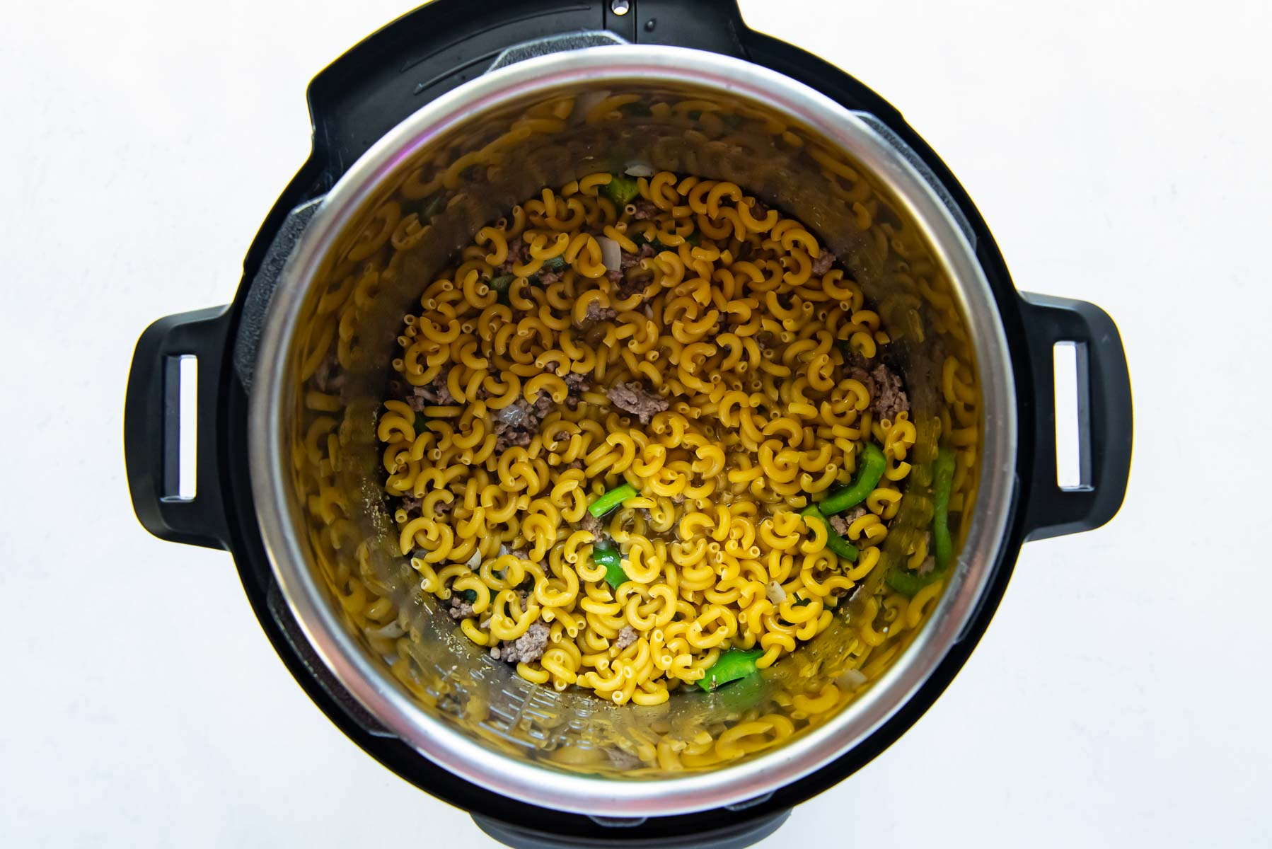 pasta spread into an even layer in pot