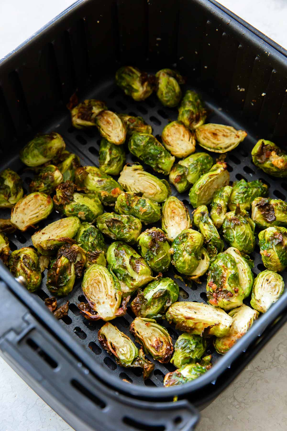 cooked brussels sprouts in air fryer basket