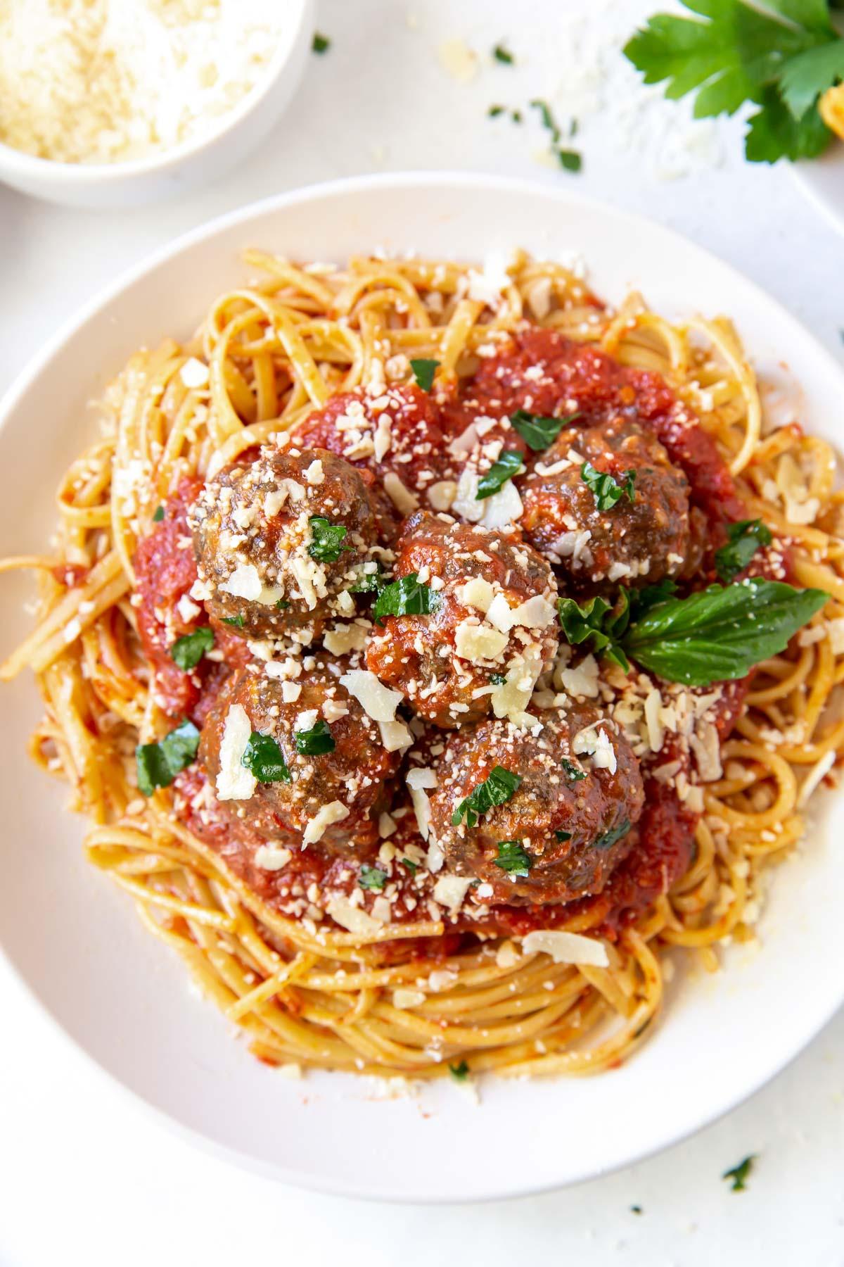 meatballs served with spaghetti and marinara sauce