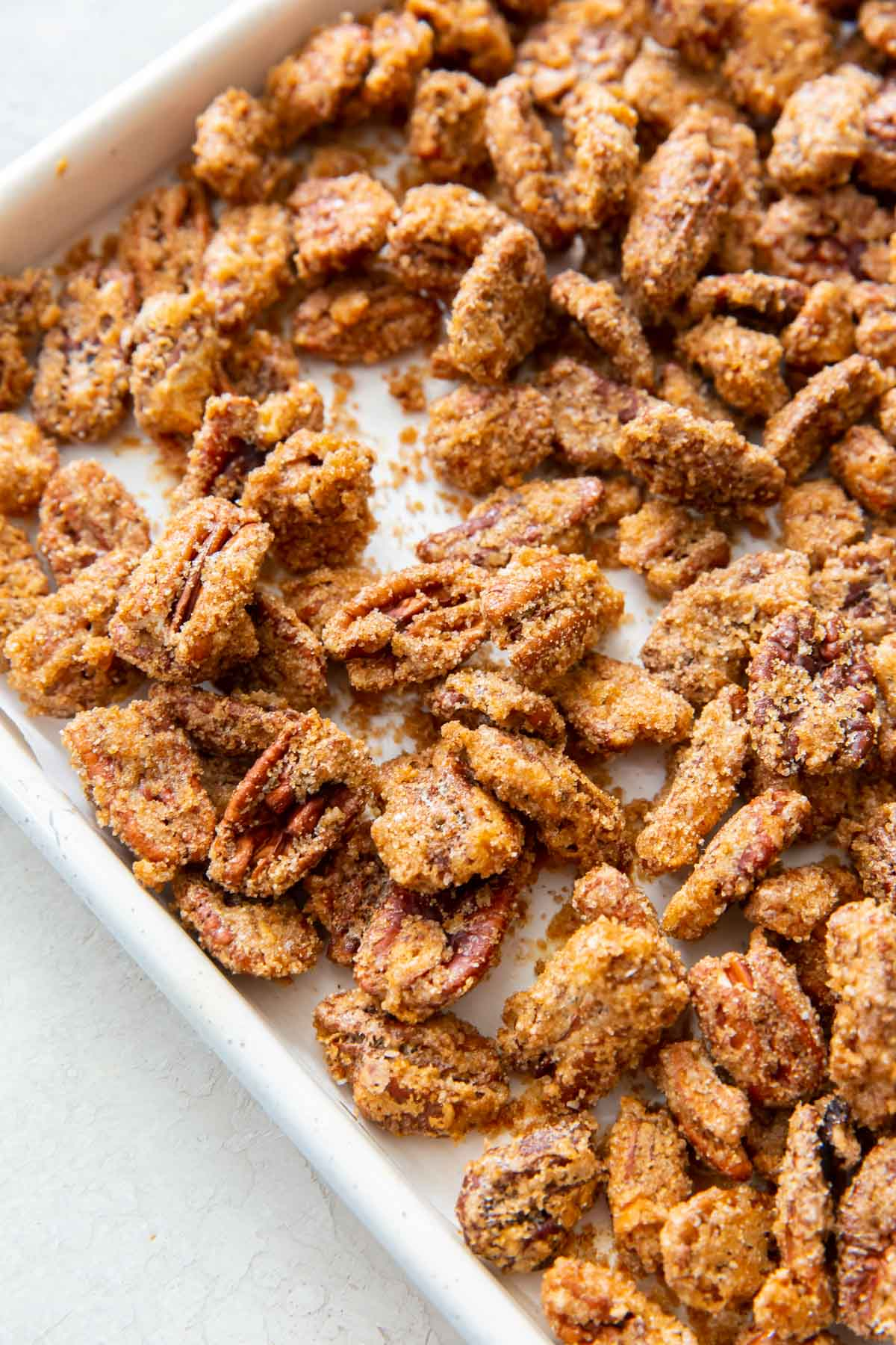 roasted candied pecans on a baking sheet