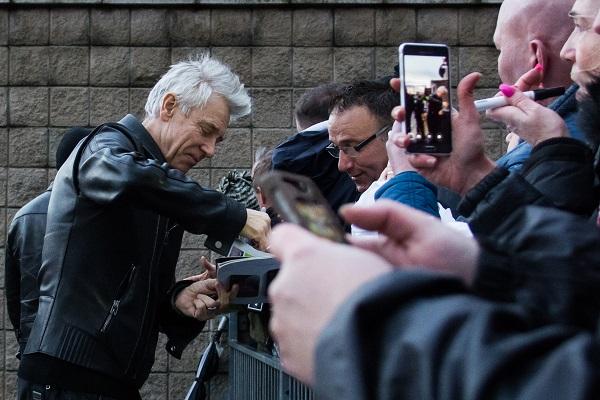 Adam of U2 meeting fans in Belfast 18 Nov 2015 outside the SSE A