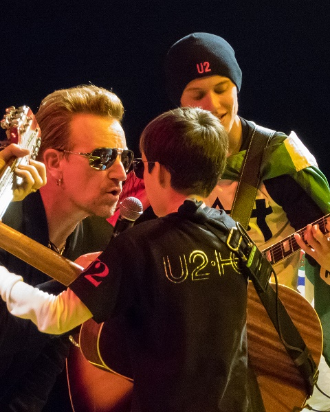 Bono with Alexander and Paco on stage in Belfast on 19th of November 2015