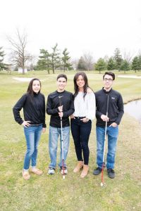 Kristin Smedley and her children standing on a golf course