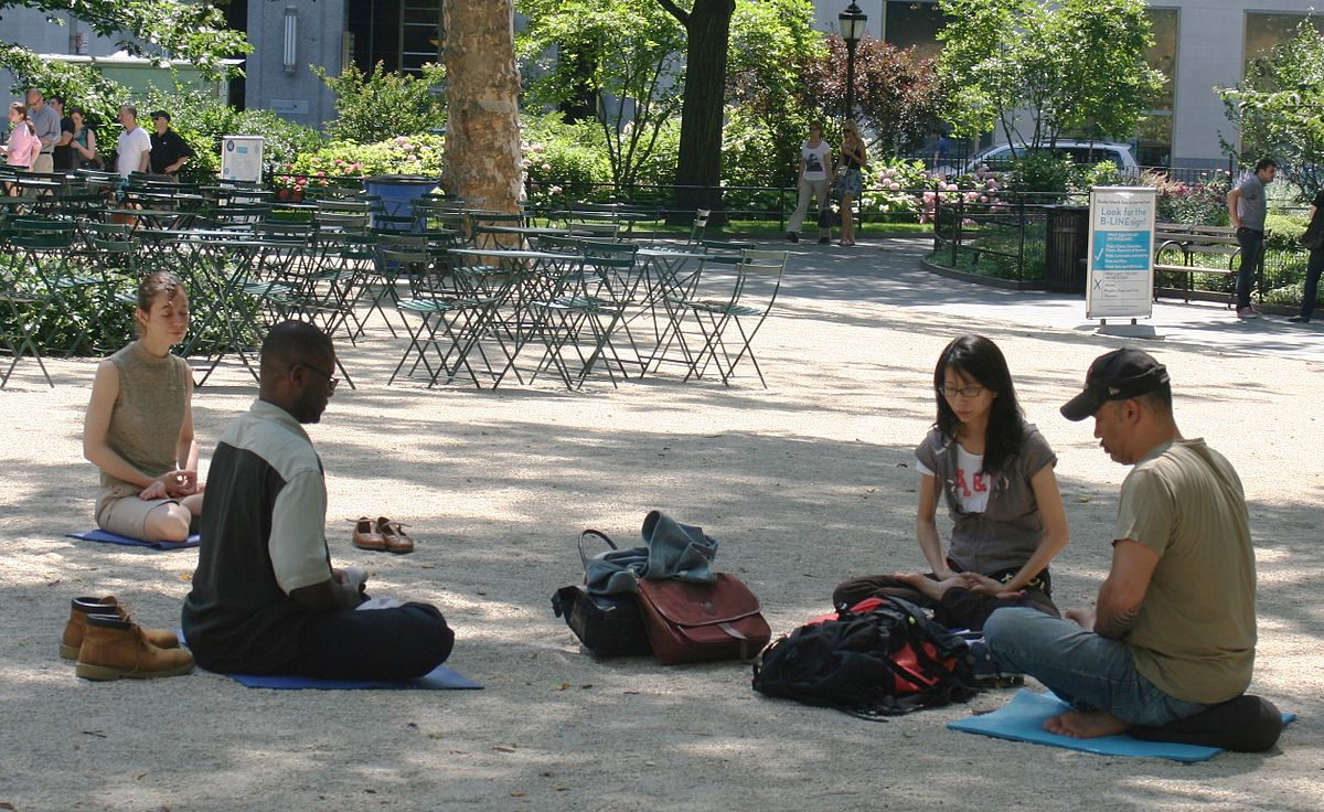 1200px-Meditating_in_Madison_Square_Park