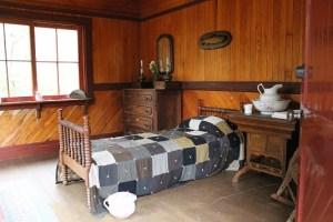 bedroom in log house