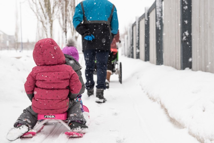 A family out on a winter walk during a documentary family photography session.