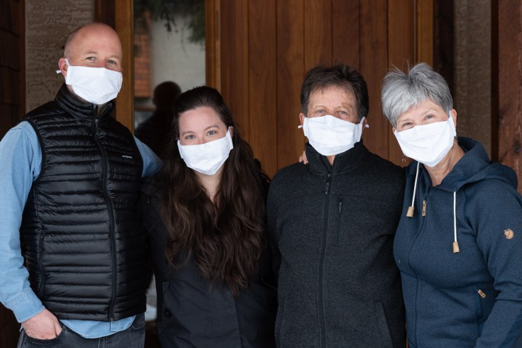 Front Steps image of Sam Welsh and family wearing masks during covid-19 pandemic.