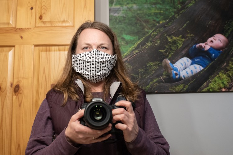 A self-portrait of Kristy Wolfe wearing a mask.