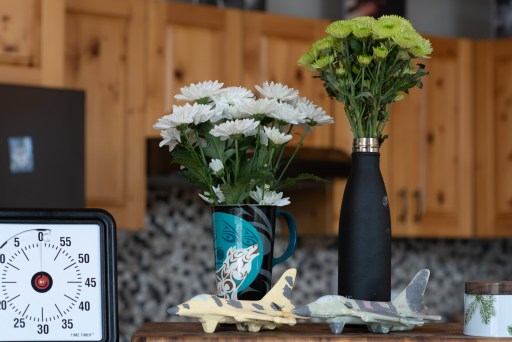A visual timer, flowers in makeshift vases and Crock-a-doodle jets.