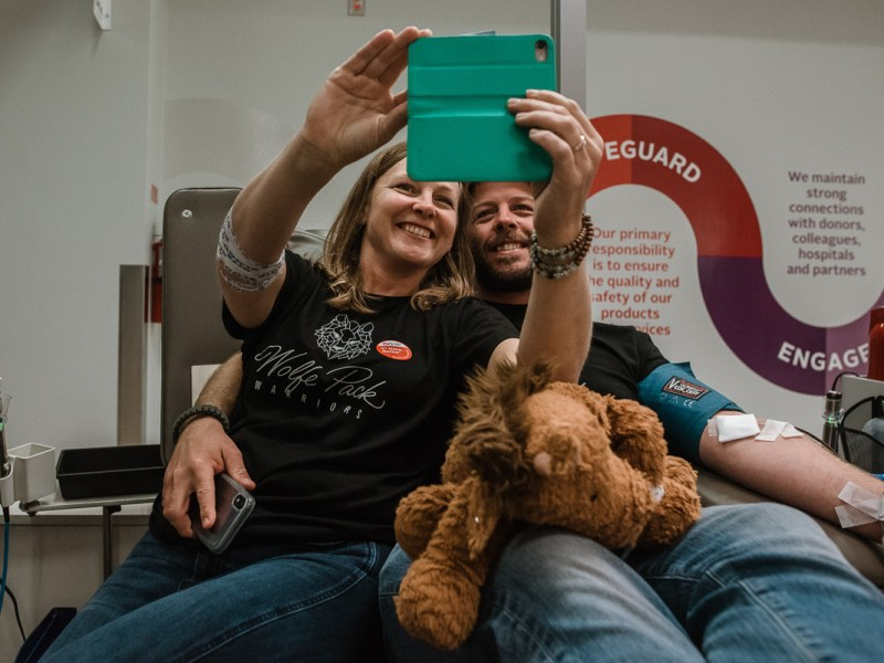 Parents donating blood during their son's heart surgery. Photo credit Slice of Love Photography