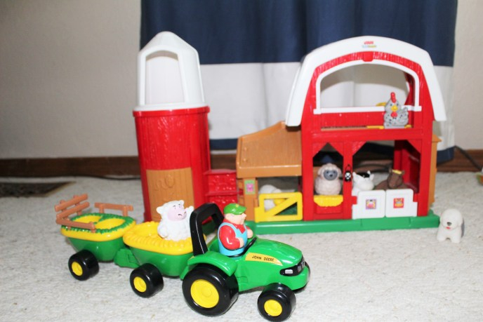 An invitation to play: setting up a farm scene for my son.