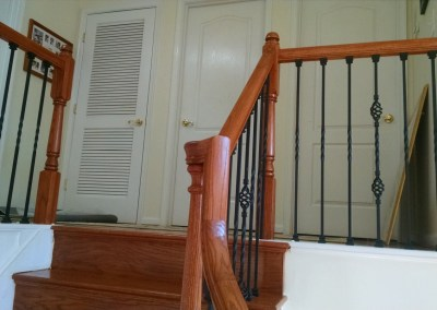 Zambrano New hardwood, Stained Rails and Wrought Iron Pickets in Manassas