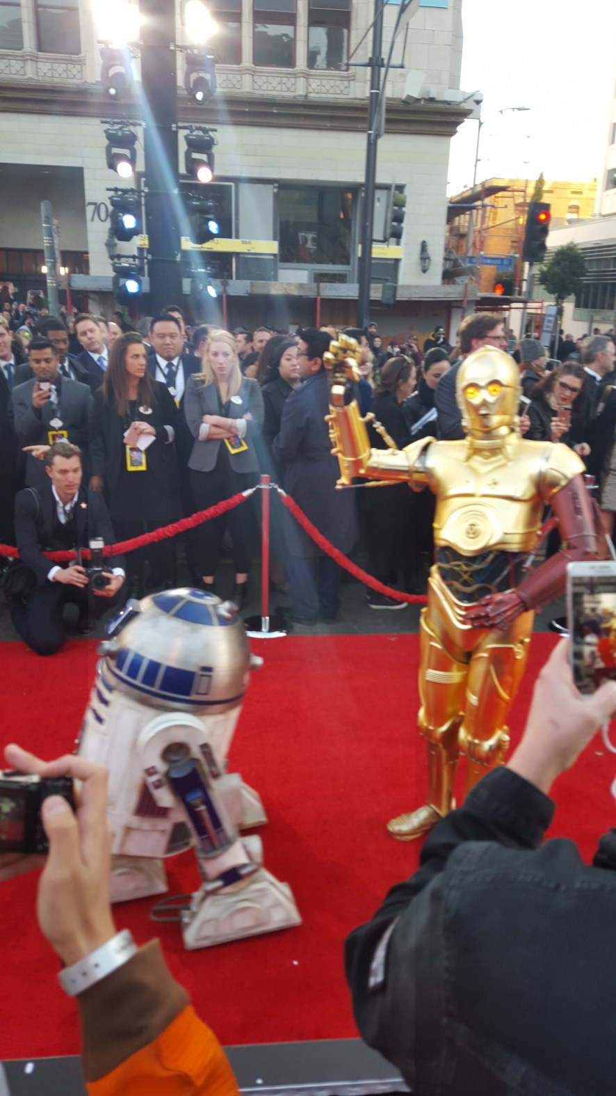 R2-D2 and C-3PO walk the carpet.